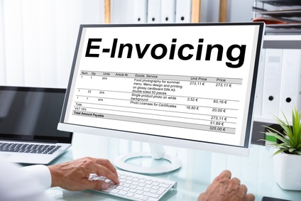 Mature Businessman Preparing E-invoicing Bill On Computer At Workplace